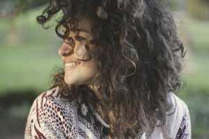 smiling curly brunette